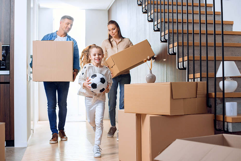 A father, mother, and daughter family moving into their new house after it passed a thorough home inspection